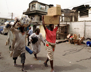 PEOPLE FLEE AGEGE AREA OF LAGOS FOLLOWING TRIBAL CLASHES.