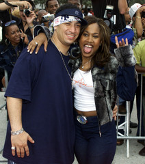 Recording artists Kid Capri (L) and Sunshine Anderson (R) pose for photographs as they arrive at the..