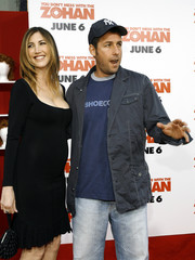 """Director and cast member Sandler poses with his wife Jackie at premiere of """"You Don't Mess with the Zohan"""" in Hollywood"""
