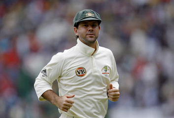 Australia's captain Ponting runs back towards pavilion after the end of India's first innings during their first test cricket match in Bangalore