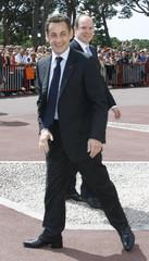 Prince Albert II of Monaco and France's President Nicolas Sarkozy attend a ceremony in Monaco