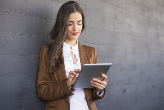 woman in business outfit with tablet