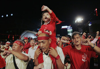 Protesters sing during rally in Taipei