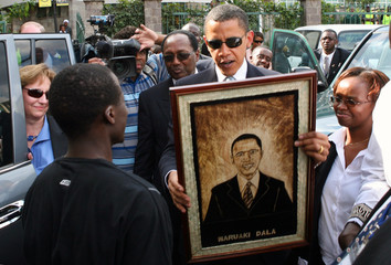 US Senator Obama receives a gift from one of his supporters in Nairobi