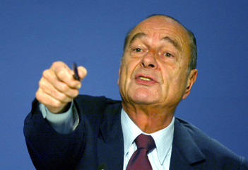 French President Jacques Chirac gestures as he answers newsmen after a working dinner with European ..