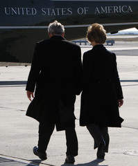 U.S. President George W. Bush and first lady Laura Bush walk  towards Marine One at John F. Kennedy Airport in New Yorkat JFK Airport in New York