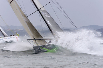 America One ploughs through heavy seas on its way to win the race against Japan's Nippon Challenge a..