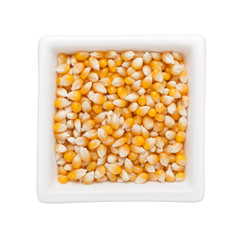 Raw corn kernels