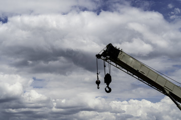 Commercial crane and hook reaching into the sky