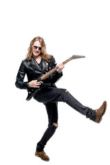 handsome rocker in sunglasses posing playing electric guitar isolated on white, rock star guitar concept