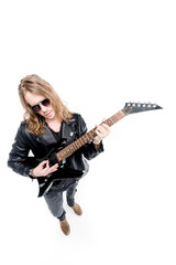 handsome rocker in sunglasses posing playing electric guitar isolated on white, electric guitar player concept