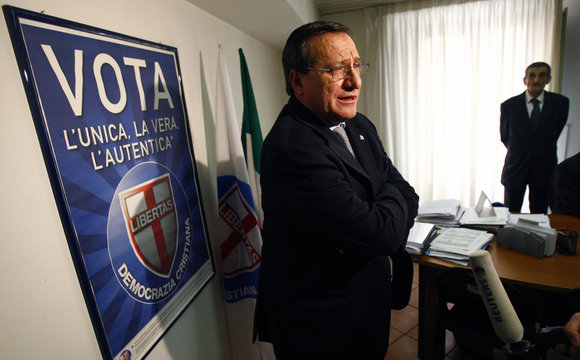 Secretary of Democrazia Cristiana party Giuseppe Pizza answers a reporter's question during an interview in downtown Rome