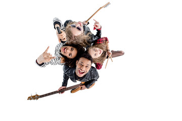 Overhead view of happy young rock and roll band posing with instruments isolated on white