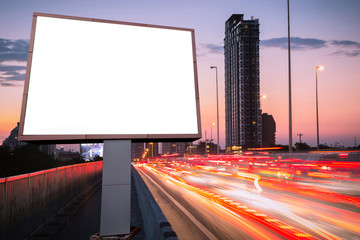 left blank billboard on light trails, street and urban in the twilight - can advertisement for display or montage product or business.