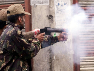 INDIAN POLICE FIRE TEAR GAS TO DISPERSE DEMONSTRATORS IN SRINAGAR.