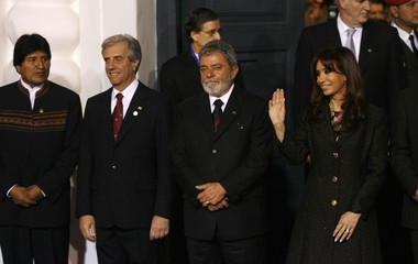 Argentina's President Fernandez waves during family photo at Mercosur summit in Tucuman