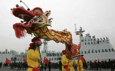 Chinese residents in Japan perform a dragon dance as Chinese naval missile destroyer Shenzhen docks at Harumi pier in Tokyo
