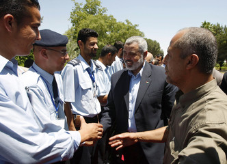 Hamas leader Haniyeh is greeted at Rafah crossing