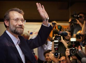 Ali Larijani, former Islamic Republic of Iran Broadcasting (IRIB) waves to journalists before ...