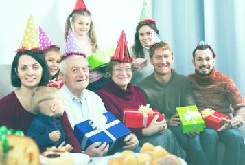 Happy large family making numerous photos