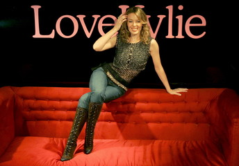 Australian singer and actress Kylie Minogue (C) launches a new collection of stockings for her under..