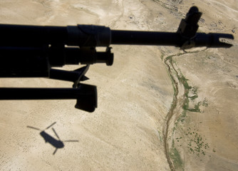 A U.S. army Chinook helicopter flies to Forward Operating Base Airborne over the mountains of Wardak Province