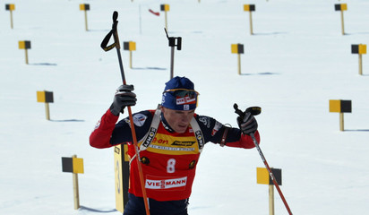 Raphael Poiree of France leaves shooting range during men's 15 km Mass Start event in Hochfilzen.