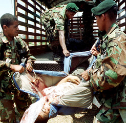 COLOMBIAN SOLDIERS CARRY THE BODY OF A REBEL IN DAGUA.