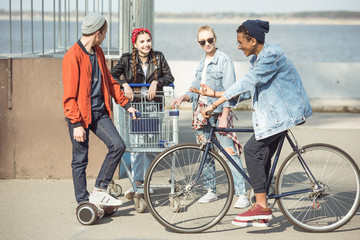 stylish teenagers spending time in skateboard park, hipster style concept
