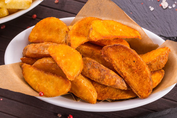Potatoes in a rural, deep fried, are served as a separate dish or as a garnish for meat