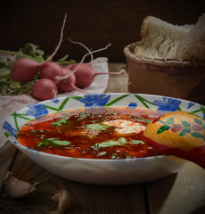 Russian borscht with sour cream and dill