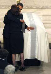 U.S. President Obama hugs Vicki Reggie Kennedy as he touches the coffin of U.S. Senator Edward Kennedy during his funeral in Boston
