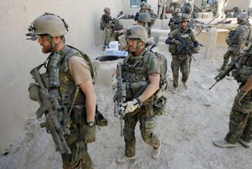 Dutch soldiers patrol in a village near Baluchi pass in Uruzgan province