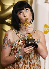 "Diablo Cody holds the oscar for best original screenplay for ""Juno"" backstage at the 80th annual Academy Awards in Hollywood"