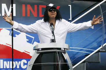 Musician and reality show star Gene Simmons speaks to the crowd before the IRL IndyCar Series Honda Indy Toronto race