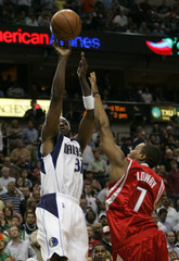 Mavericks guard Terry shoots a basket over Rockets guard Lowry in NBA game in Dallas