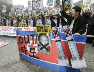 Conservative protesters shout during an anti-North Korea rally in Seoul