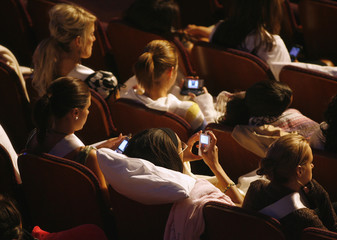 Contestants use their iPods, mobile phones or just rest to pass the time during rehearsals for the 56th Annual Miss USA competition in Hollywood
