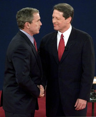 VICE PRESIDENT AL GORE SHAKES HANDS WITH TEXAS GOVERNOR GEORGE W BUSH.