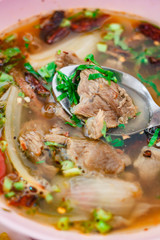 Delicious hot spicy soup with meat in a bowl.
