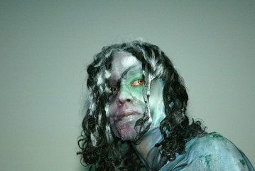 -PHOTO TAKEN 15MAR03- A model, painted by France's artist Erwan Simon, takes part in the sixteenth I..