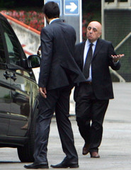 AC Milan vice-president Adriano Galliani leaves the Olympic stadium where a soccer league trial is taking place in Rome