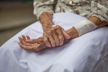 Hands of the old woman.