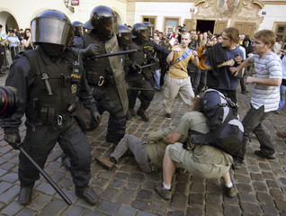 Czech riot policemen fight with demonstrators during an anti-U.S. protest in Prague
