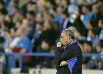 Israel's soccer team head coach Avraham Grant watches match in Tel Aviv.