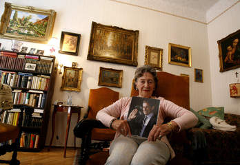 Mariann Sarkozy holds a picture of Nicolas Sarkozy in her flat in Budapest