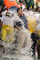 Michigans Carr gets ice bath after beating Notre Dame in South Bend Indiana