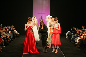 Designer Nadwa al-Awar greets her audience at the end of her fashion show in Beirut