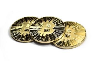 Three shiny bitcoin coins on white background