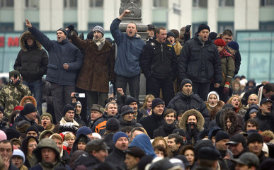 Demonstrators shout slogans as they gather for a protest in the capital Minsk